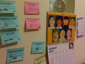 Flashsticks with words related to time stuck next to calendar